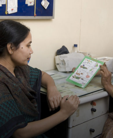 A health worker talks to a patient