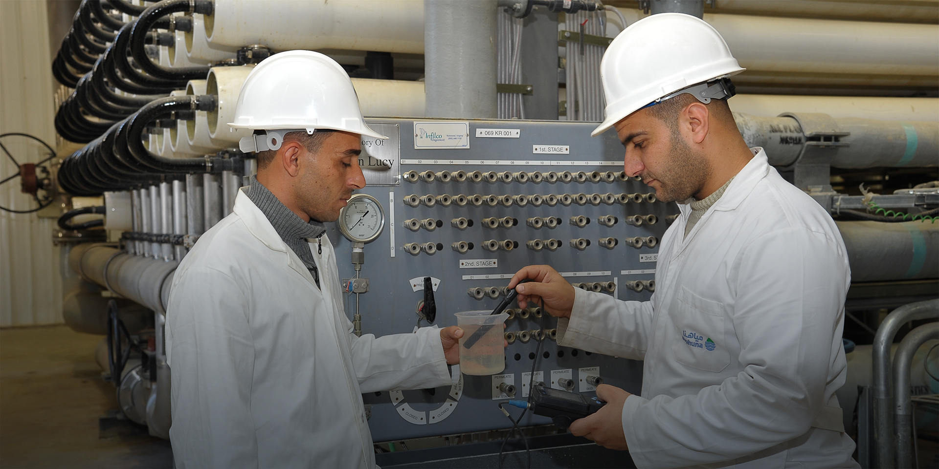 men in Jordan water testing facility