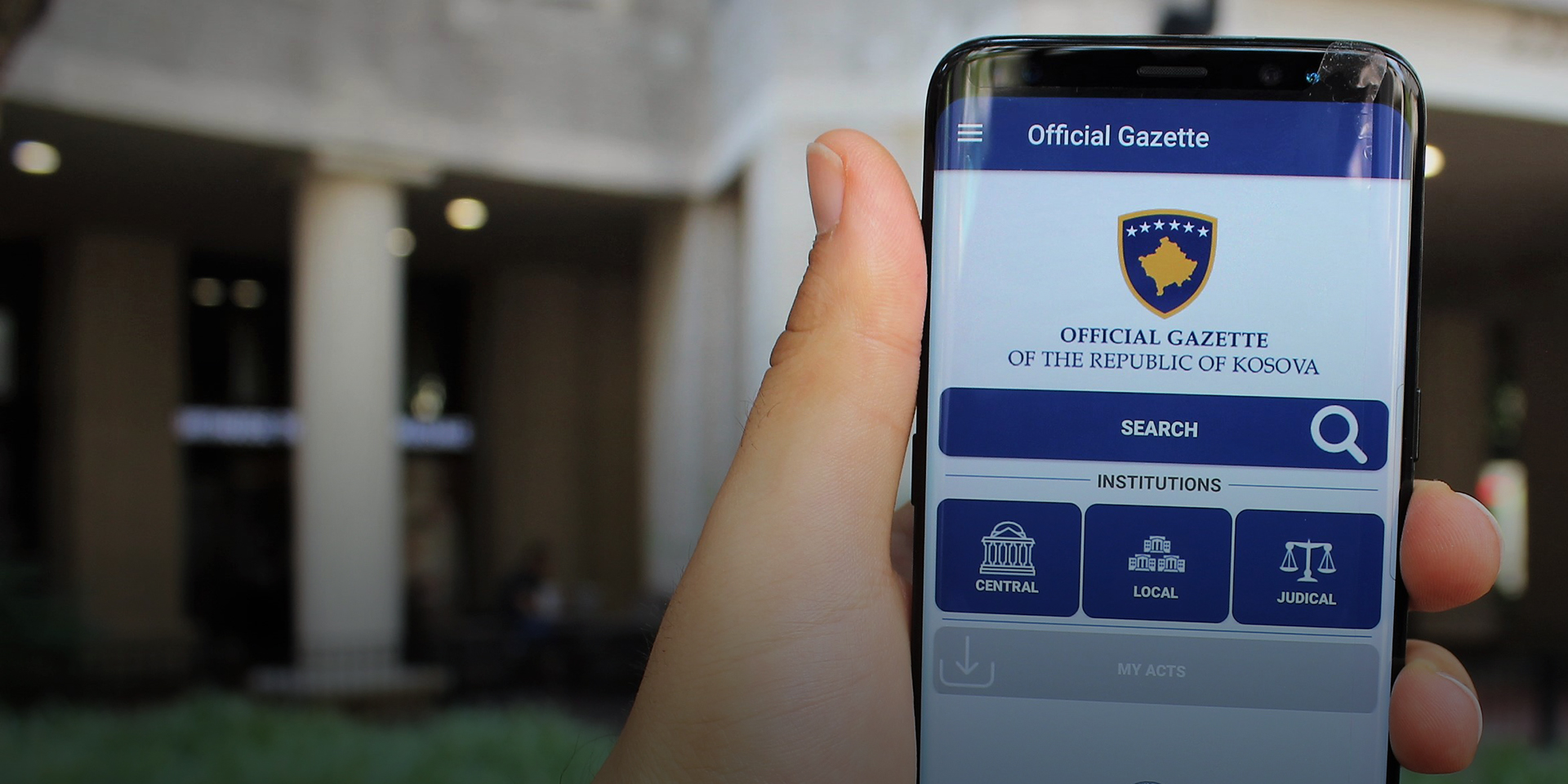 A phone displays the Official Gazette of Kosovo mobile app