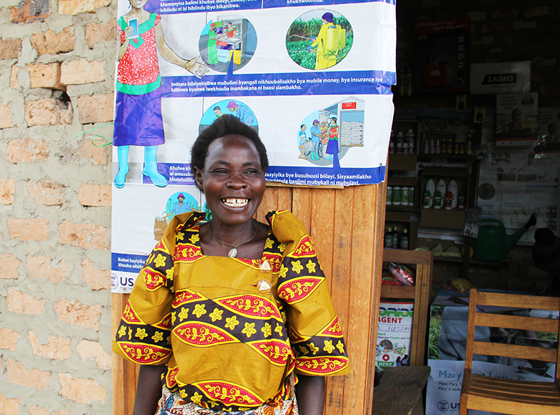 After working with a village agent, Farmer Maria Goretti Masala has seen her crop yields increase by approximately 400 percent.