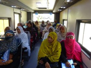 Participants in the Pakistan PEEP program on one of the mobile training buses