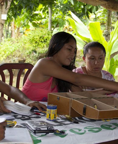 Women meet as part of a community savings group in Colombia.
