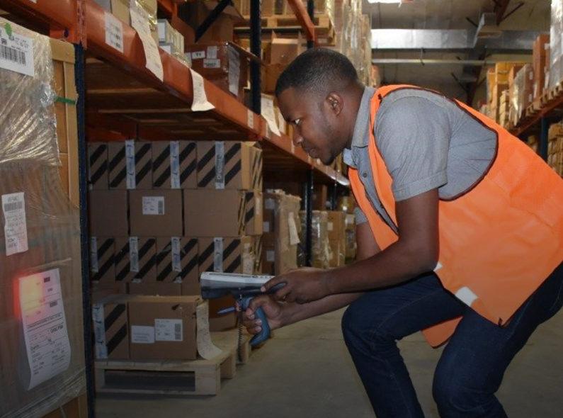 warehouse worker scanning bar codes