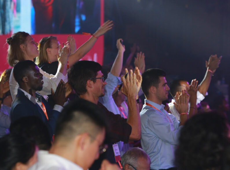 Attendees of the 2019 UNLEASH Global Innovation Lab cheer during a general session.