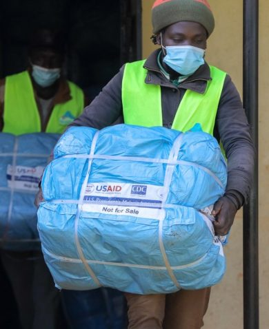 A person carries USAID supplies