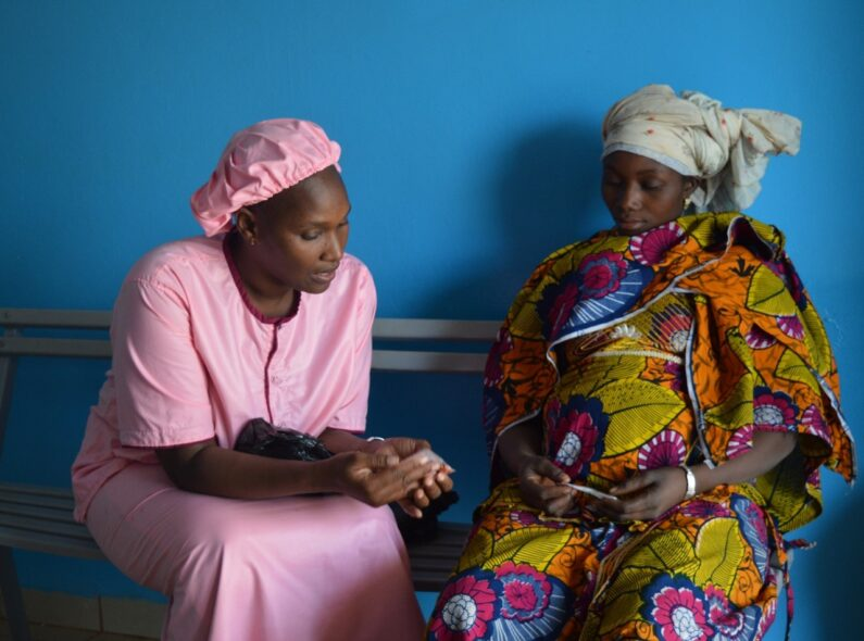 Midwife Mama Diancoumba (left) provides prenatal care to one of her clients at the Selingué Health Center in Mali. Read her story here. Credit: HRH2030