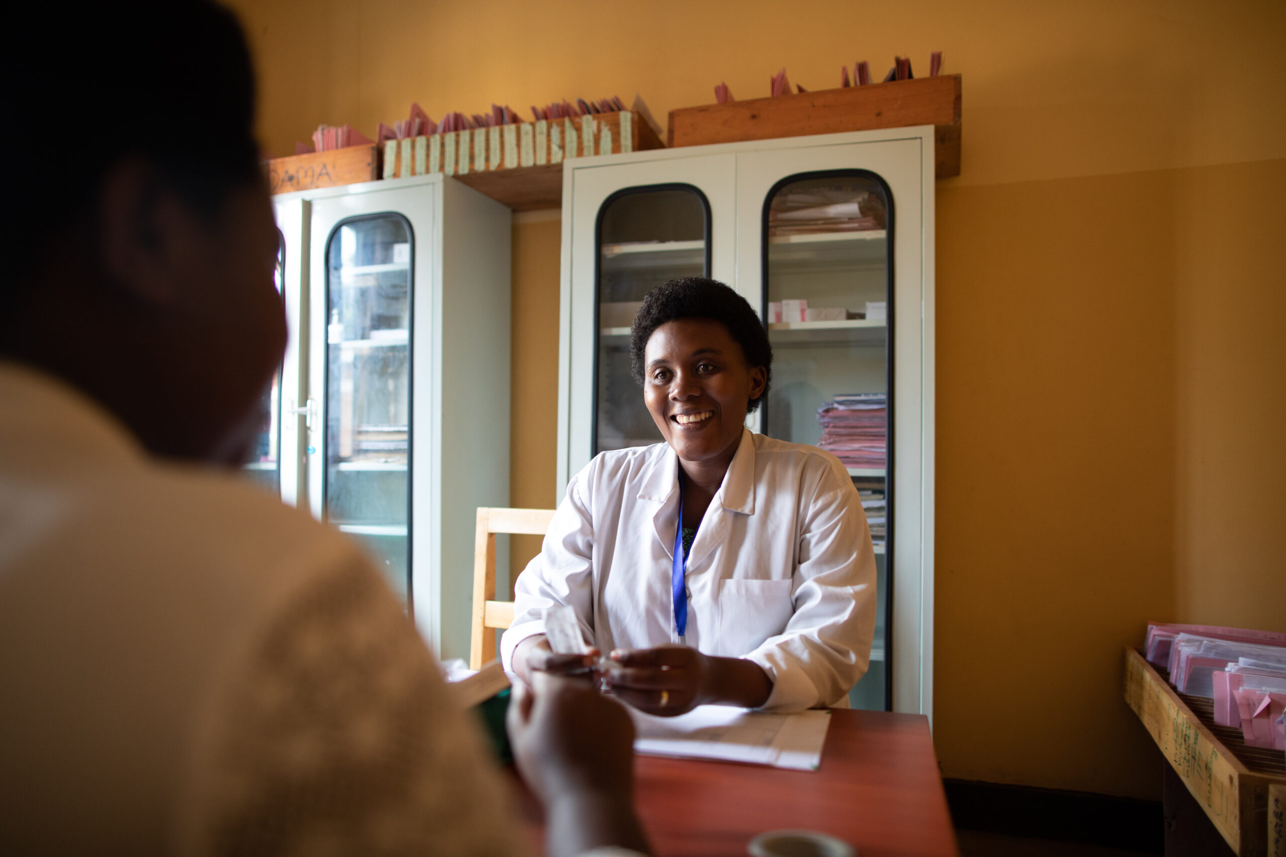 Doctor provides counseling service to patient in Rwanda.
